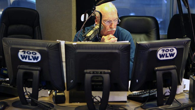 WLW radio host Jim Scott waits to go back on air during a commercial break Tuesday, when he announced his retirement.