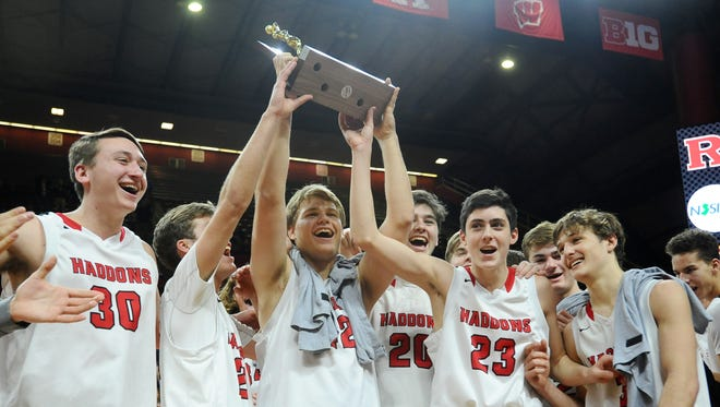 Haddonfield celebrates after defeating Newark Central 62-45 in the Group 2 boys basketball state final at Rutgers University in Piscataway on Sunday. 03.11.18.