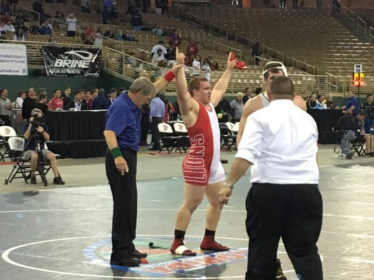 Leon senior Gabe Beyer's hand is raised to signal victory in the FHSAA Class 2A state finals for 285 pounds on Saturday night in Kissimmee.