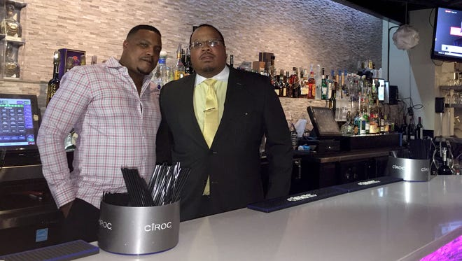 Scott Bridgewater, left, and Chris Williams, co-operators of the Centre Park Bar in Detroit, say police have harassed their customers and issued a frivolous noise complaint this summer since they voiced opposition to the sale of the building they lease to Dennis Archer Jr.