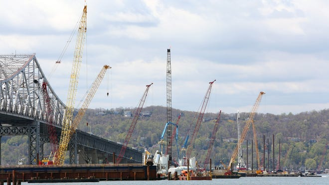 Barge-carried cranes work on the Tappan Zee Bridge project just off the Tarrytown shore May 1.
