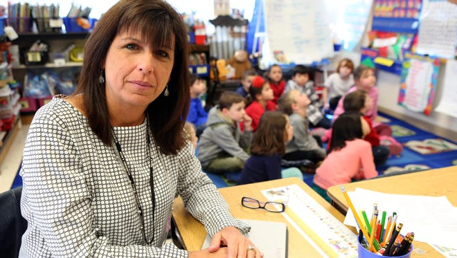 Bedford Elementary School principal Peggy Galotti is seen Feb. 23 2015 in a first grade class taught by Elena Garcia. Gov. Cuomo wants 50 percent of teacher evaluations to be based on independent observations, but many critics say such a system devalues the principal's role.