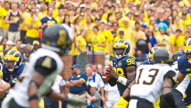 Michigan quarterback Devin Gardner (98) looks for an open receiver in the second quarter of Saturday's game against Appalachian State at the Big House.