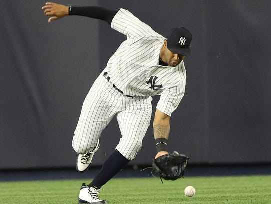 Aaron Hicks fields this single hit to centerfield in