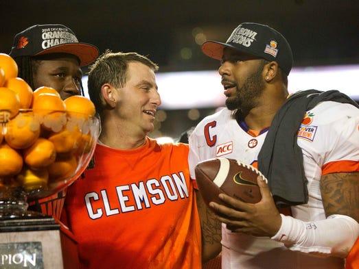 Clemson quarterback Tajh Boyd and coach Dabo Swinney celebrate after defeating Ohio State 40-35 to win the Orange Bowl in Miami Gardens, Fla.