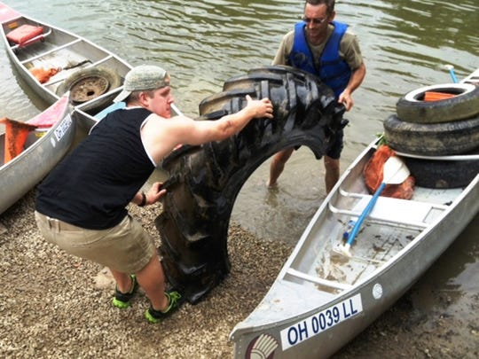 Volunteers help with river clean-up.