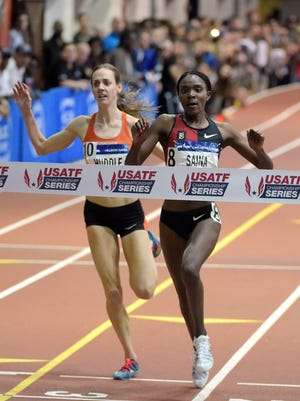 Kenya's Betsy Saina, right,   defeats Molly Huddle by 0.13 seconds to win the women's 5,000 meters at the 109th Millrose Games at The Armory in New York City.