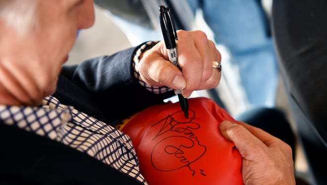 """Former World Boxing Association champion Ray """"Boom Boom"""" Mancini signs a boxing glove for Jay Umbenhouer of Reading during the 52nd annual York Area Sports Night Thursday, Feb. 11, 2016, at Heritage Hills."""