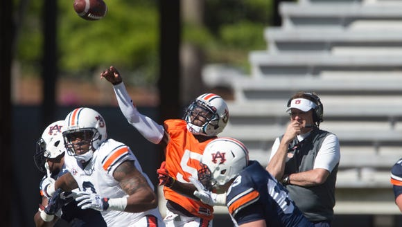 Auburn quarterback John Franklin III (5) throws a pass