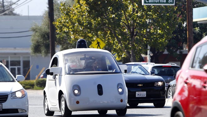 A Google self-driving car travels eastbound on San Antonio Road in Mountain View, Calif., on Wednesday, Oct. 22, 2015.