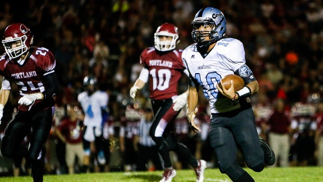 Lansing Catholic junior quarterback Michael Lynn III ranks among the area's leaders in passing and rushing.