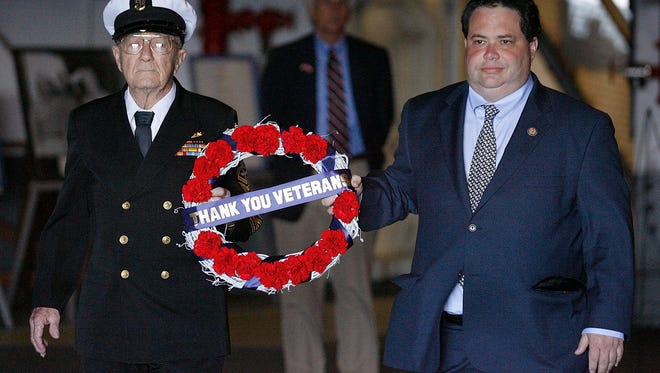TODD YATES/CALLER-TIMESRobert McKinley, World War II veteran who served aboard the USS Enterprise during the battle of Midway, and US Congressman Blake Farenthold (left to right) prepare to drop a wreath honoring veterans in to the Corpus Christi Bay during Veteran's Day celebration in 2011.