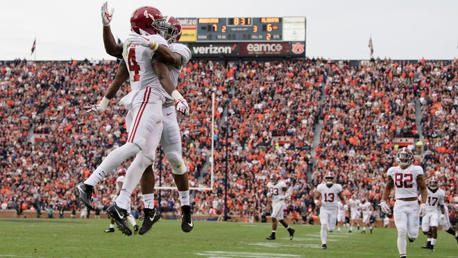 Alabama wide receiver Jerry Jeudy (4) celebrates with Alabama wide receiver Calvin Ridley (3) after scoring a touchdown during the Iron Bowl NCAA football game between Auburn and Alabama on Saturday, Nov. 25, 2017, in Auburn, Ala.
