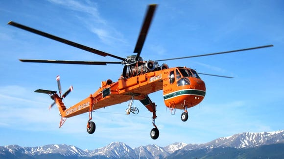 An S64-F helicopter such as this one, which can carry a load of up to 25,000 pounds, will be making a flyover at Chimney Rock State Park in July to deliver construction equipment.