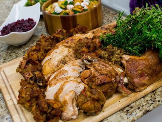 A roasted turkey is plated in the Tony Chachere's Creole