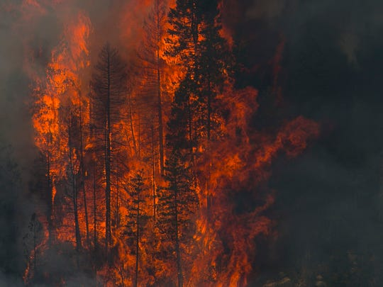 Flames rise from the Slide Fire on May 23 in Oak Creek Canyon near Sedona. Despite recent destructive blazes, the Legislature has enacted few measures that would ease the fire risk.