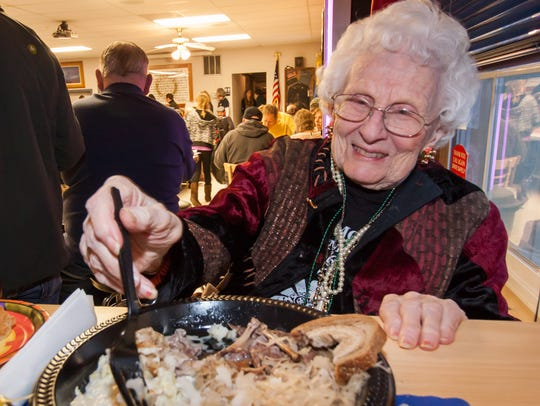 Lillian McNulty enjoys a hearty dinner during the 2015