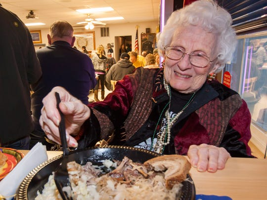 Lillian McNulty enjoys a hearty dinner during the 2015 Delafield Coon Feed. McNulty, who died Oct. 13, continued the legacy of her late husband by annually organizing the Feed to support the Legion's youth baseball programs.