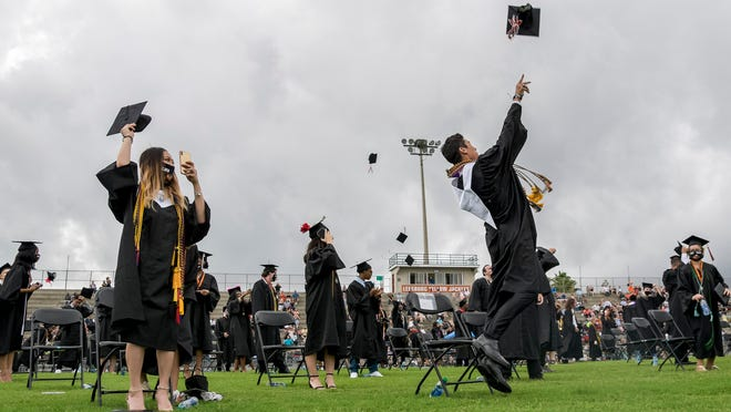 Graduates throw caps in the air during the commencement ceremony at Leesburg High School on Saturday, June 13, 2020.