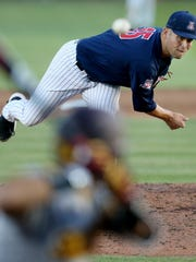 Arizona pitcher Cody Deason (15) delivers a pitch during