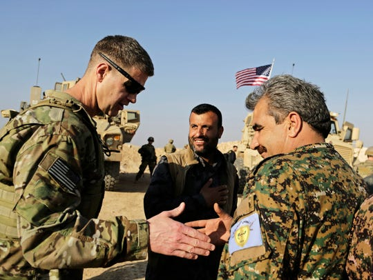 U.S. Army Maj. Gen. Jamie Jarrard, left, thanks Manbij Military Council commander Muhammed Abu Adeel during a visit to a small outpost near the town of Manbij in northern Syria on Feb. 7, 2018.