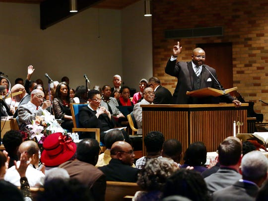 Pastor Derek Williams speaks to the crowd during Sunday's Martin Luther King Jr. service at Mount Calvary Baptist Church.