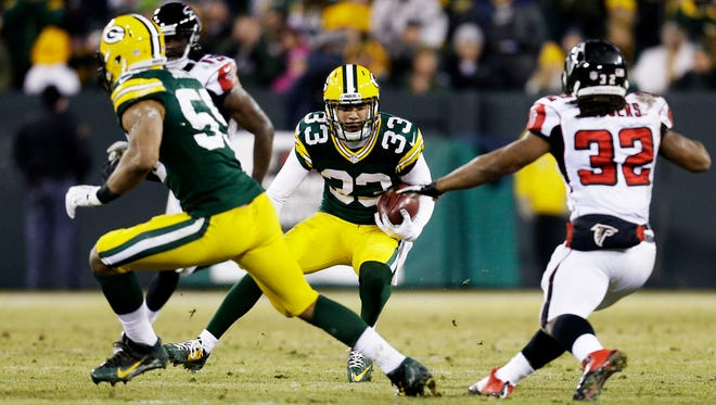 GREEN BAY, WI - DECEMBER 08:   Micah Hyde #33 of the Green Bay Packers returns a kick in the second quarter against the Atlanta Falcons at Lambeau Field on December 8, 2014 in Green Bay, Wisconsin.  (Photo by Mike McGinnis/Getty Images)
