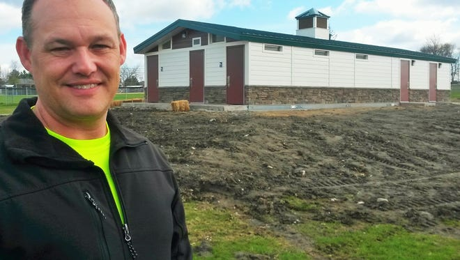Guy Goldsmith looks toward another big park-improvement season in North Liberty. Behind him is the new pavilion at Penn Meadows Park, which will offer improved restroom and snack bar facilities there.