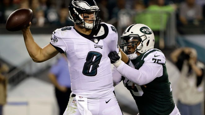 New York Jets' Xavier Cooper (75) grabs Philadelphia Eagles' Christian Hackenberg (8) during the second half of a preseason NFL football game Thursday, Aug. 30, 2018, in Philadelphia. (AP Photo/Matt Rourke)