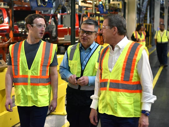 Facebook CEO Mark Zuckerberg (left) tours Ford's Dearborn