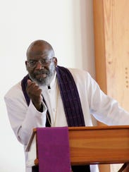 Pastor Arnold Isidore Thomas speaks to his congregation