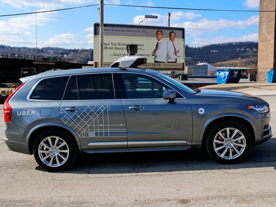 An Uber self-driving Volvo drives in Pittsburgh Friday,
