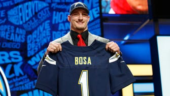 Joey Bosa (Ohio State) after being selected by the San Diego Chargers as the number three overall pick in the first round of the 2016 NFL Draft at Auditorium Theatre.