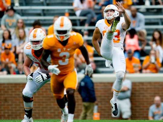 Vols punter Trevor Daniel (93) kicks during the Orange