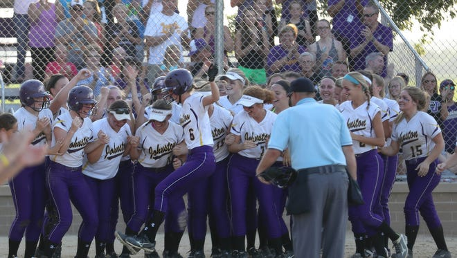 July 11, 2017; Johnston, IA, USA; The Dragons Hannah Espeland (6) jumps on home plate after launching a 3-run home-run in the top of the second inning against the Southeast Polk Rams at Johnston High School. The Dragons beat the Rams 9-3.  Mandatory Credit: Reese Strickland-Special to Register