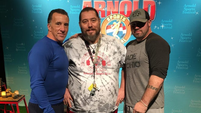 John Starner, center, is pictured with his trainer, Shawn Nutter, right, and Arnold Transformation Challenge event chair Rob Fletcher. Starner won the Arnold Transformation Challenge after losing 150 pounds in eight months.