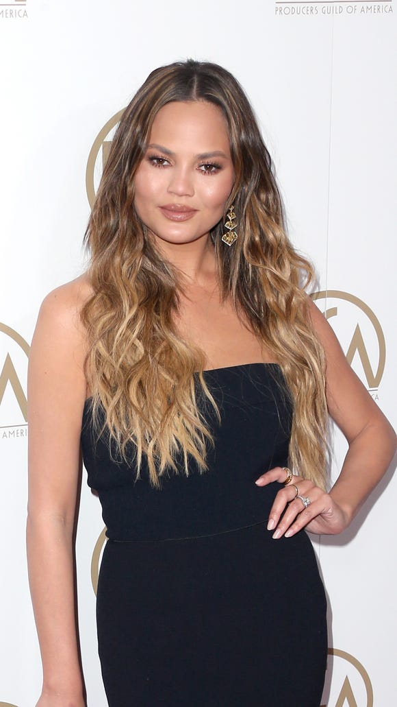 Chrissy Teigen shows off her sun-kissed locks.