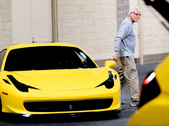 Byron Cooper walks from a 2010 458 Italia Ferrari during set up for the annual Knox News Auto Show at the Knoxville Convention Center in Knoxville, Tennessee on Thursday, February 22, 2018. The show runs from February 23-25 and features over 250 cars from dozens of manufacturers.