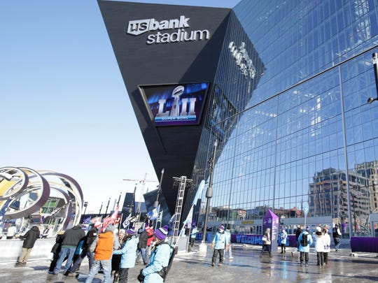 Some fans' journeys to U.S. Bank Stadium for the Super Bowl on Sunday were delayed when protestors blocked some light rail tracks.