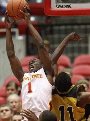 Bubu Palo grabs a rebound over Alabama State's Stephawn Brown during a game at Hilton Coliseum in Ames on Nov. 14, 2010.