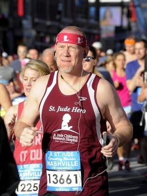 Runners participate in the Country Music Marathon Saturday April 26, 2014, in Nashville, TN.