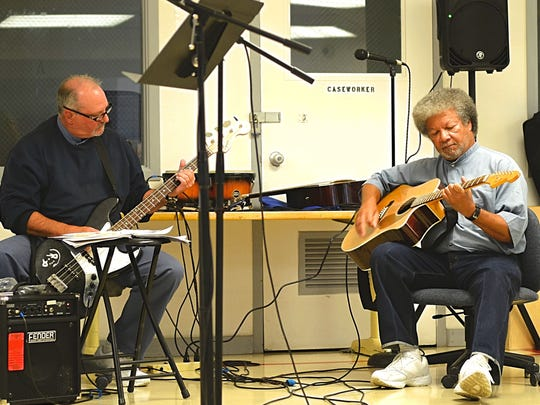 Inmates participating in a songwriting workshop perform