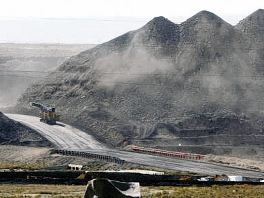 A mining vehicle moves along a road in 2013 at the Navajo (coal) Mine in Waterflow, N.M. PNM's proposed 2016 rate hikes would include funds to make its coal-fired San Juan Generating Station in Waterflow comply with EPA emissions standards.