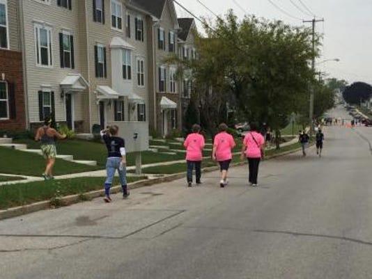 Participants in the VNA Hospice Remembrance 5K Run/Walk near the finish line of Saturday's race.