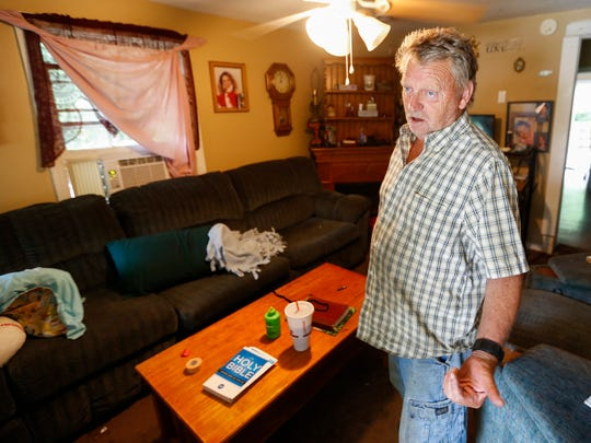 Mike Lasiter talks about what happened when he came home and saw an unknown man sitting on his couch on N Newton Avenue on Monday, June 4, 2018. He said the man ran out when he was confronted and fired at police officers who returned fire, killing him.