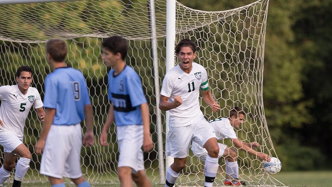Colts Neck's Louis Reale celebrates as he scores his second goal of game. Colts Neck boys soccer defeats Freehold Township in Colts Neck, NJ on September 13, 2016