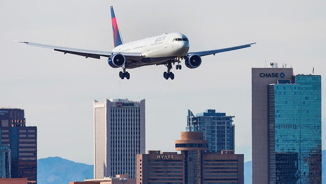 A Delta Airlines jet lands at Sky Harbor International Airport in January.