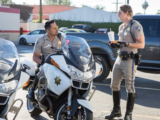 "Michael Peña and Dax Shepard in ""CHIPS."""