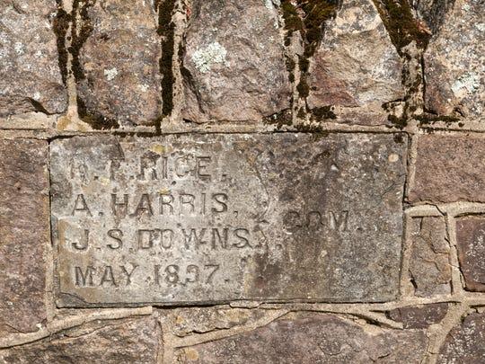 A stone plaque dates the historic foot bridge at Burnt