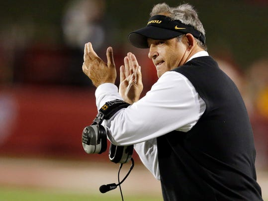 FILE - In this Sept. 21, 2013, file photo, Missouri head coach Gary Pinkel applauds his team during the second half of their 45-28 win over Indiana in an NCAA college football game in Bloomington, Ind. Pinkel has signed a new contract that boosts his annual salary above $3 million and extends his previous deal by three years. (AP Photo/Darron Cummings, File)